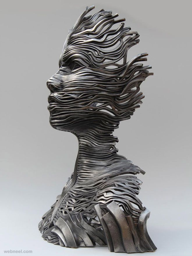 3-girl-face-steel-scultpure-by-gil-bruvel.jpg