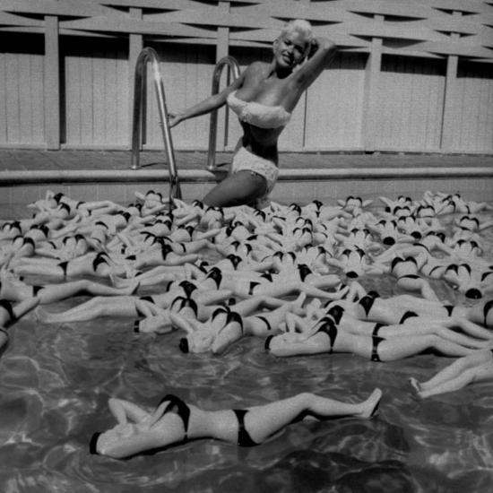 actress-jayne-mansfield-posing-with-shaped-hot-water-bottles-floating-around-her-at-her-pool_u...jpg